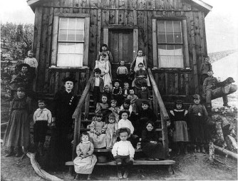 Blanche LaMont and her students pose in front of their schoolhouse in Hecla, Montana, in 1893.