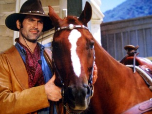 "Bruce Campbell as Brisco County Jr. with one of the horses that played his faithful sidekick Comet in ""The Adventures of Brisco County, Jr."""