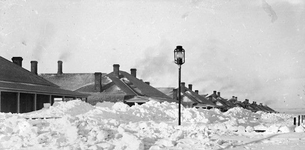 Buildings at Nebraska's Fort Niobrara behind piles of snow that fell in the Schoolhouse Blizzard of 1888. Photo credit: John A. Anderson/Nebraska State Historical Society.
