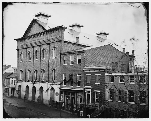 Ford's Theatre in April 1865, after Lincoln's assassination. Note the guards at the entrance and the crepe draped from the windows.