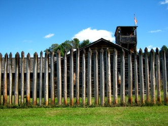 The Fort at No. 4's perimeter fence consisted of stockade poles that were too tall to climb over, too close together for a man to squeeze through but too far apart to offer cover from the men shooting from the roofs of the buildings inside.