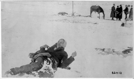 Chief Big Foot's frozen body lays in the snow at Wounded Knee.